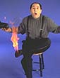 San Francisco magician, Paul Nathan funny picture with his foot on fire
